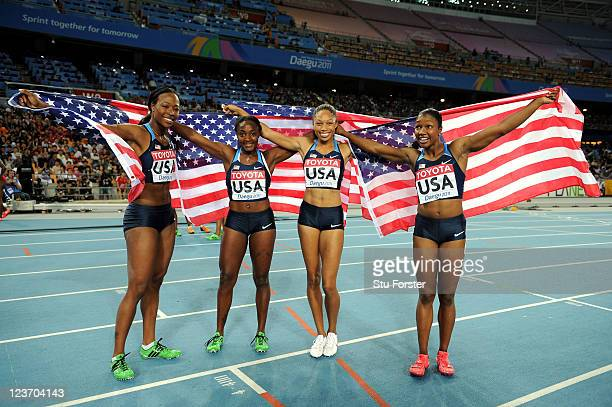 Marshevet Myers, Bianca Knight, Allyson Felix and Carmelita Jeter of the USA celebrate victory in the women's 4x100 metres relay final during day...