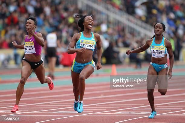 Marshevet Myers of USA wins the women's 100m from Carmelita Jeter of USA and Kelly-Ann Baptiste of Trinidad during the Aviva London Grand Prix at...