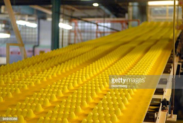 Marshmallow candy Peeps chicks move down a conveyor belt inside the Just Born Inc manufacturing facility in Bethlehem Pennsylvania US on Tuesday...