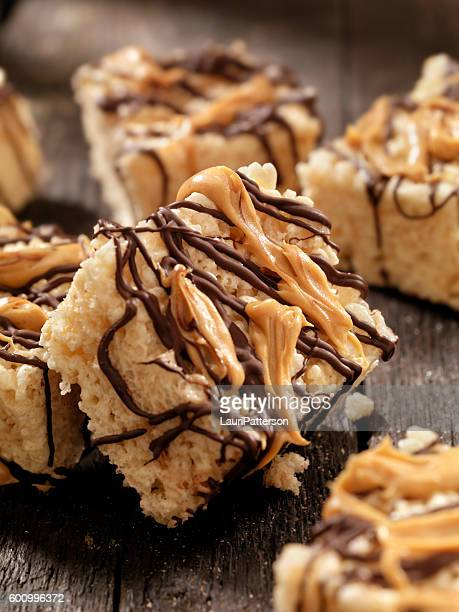 marshmallow crispy rice squares with chocolate and peanut butter - crunchy stock pictures, royalty-free photos & images