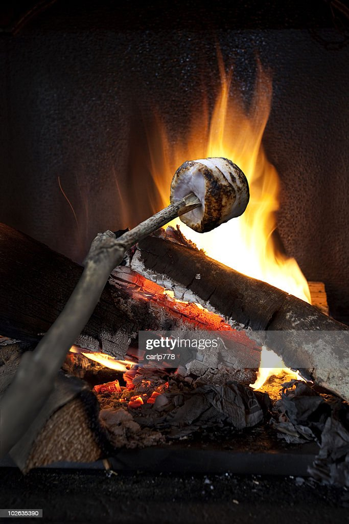 marshmallow roasting over a fire stock photo getty images