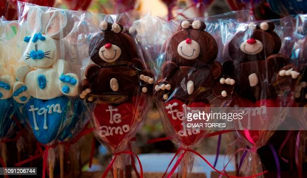 Marshmallows dolls to celebrate Saint Valentine's day for sale at a stand at a street of Mexico City on February 14 2012 AFP PHOTO/OMAR TORRES