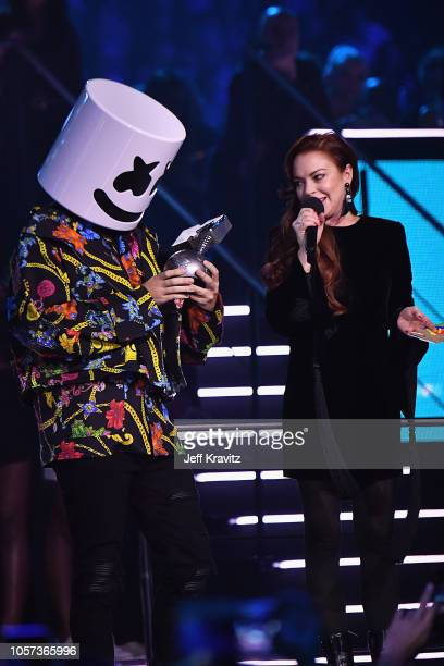 Marshmello accepts the award for Best Electronic Artist from Lindsay Lohan on stage during the MTV EMAs 2018 on November 4 2018 in Bilbao Spain