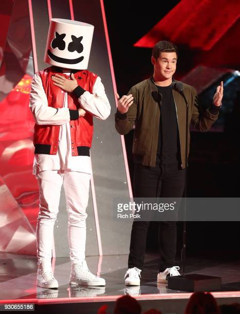 Marshmello and Adam DeVine speak onstage during the 2018 iHeartRadio Music Awards which broadcasted live on TBS TNT and truTV at The Forum on March...