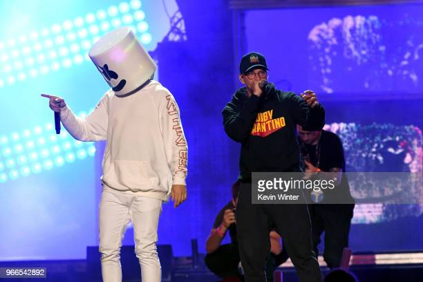 Marshmello and Logic perform onstage during the 2018 iHeartRadio Wango Tango by ATT at Banc of California Stadium on June 2 2018 in Los Angeles...