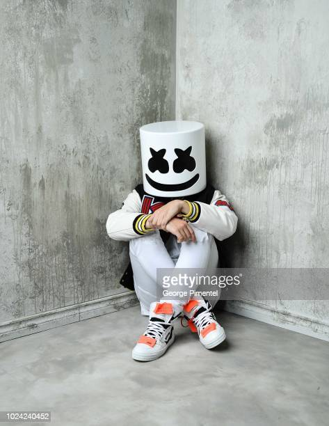 Marshmello poses in the 2018 iHeartRADIO MuchMusic Video Awards Portrait Studio at MuchMusic HQ on August 26 2018 in Toronto Canada
