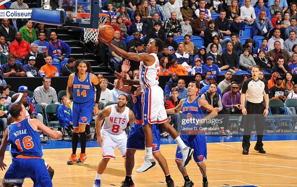 MarShon Brooks #9 of the Brooklyn Nets drives to the basket against the New York Knicks on October 24, 2012 at the Nassau Veterans Memorial Coliseum in Long Island, New York.