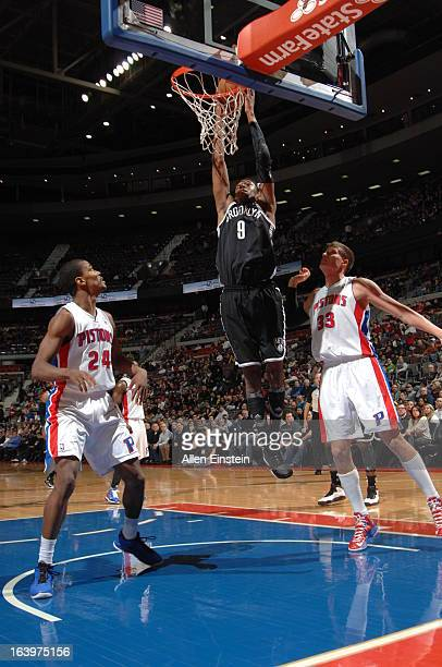 MarShon Brooks of the Brooklyn Nets dunks against Kim English and Jonas Jerebko of the Detroit Pistons on March 18 2013 at The Palace of Auburn Hills...