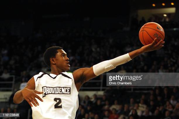 Marshon Brooks of the Providence Friars drives for a shot attempt against the Rhode Island Rams at the Dunkin' Donuts Center on December 4 2010 in...