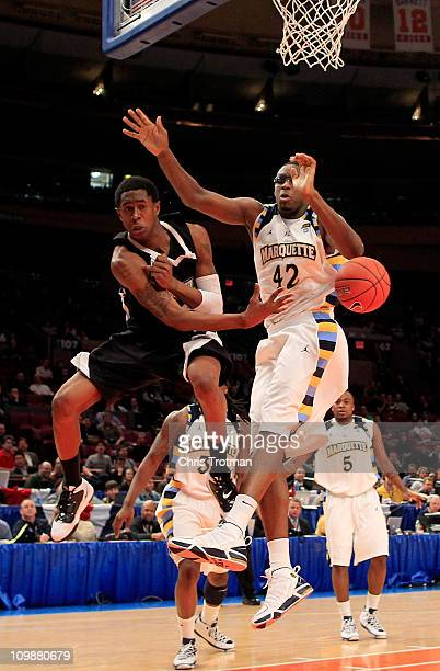 Marshon Brooks of the Providence Friars passes the ball against Chris Otule of the Marquette Golden Eagles during the first round of the 2011 Big...