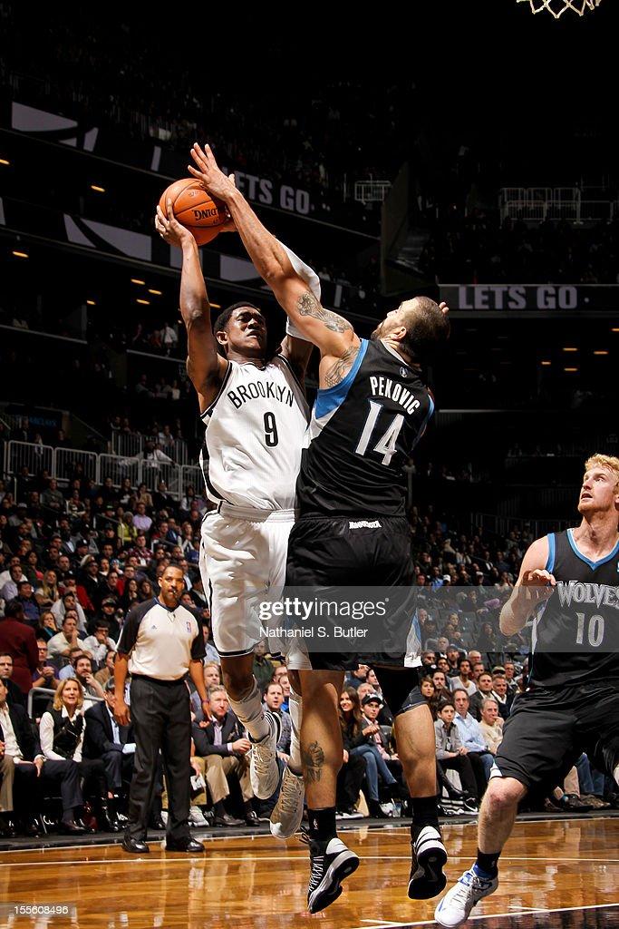 MarShon Brooks #9 shoots against Nikola Pekovic #14 of the Minnesota Timberwolves on November 5, 2012 at the Barclays Center in Brooklyn, New York.