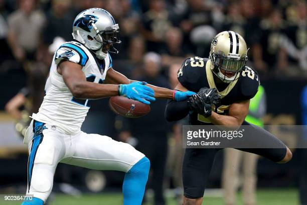 Marshon Lattimore of the New Orleans Saints breaks up a pass to Devin Funchess of the Carolina Panthers during the second half of the NFC Wild Card...
