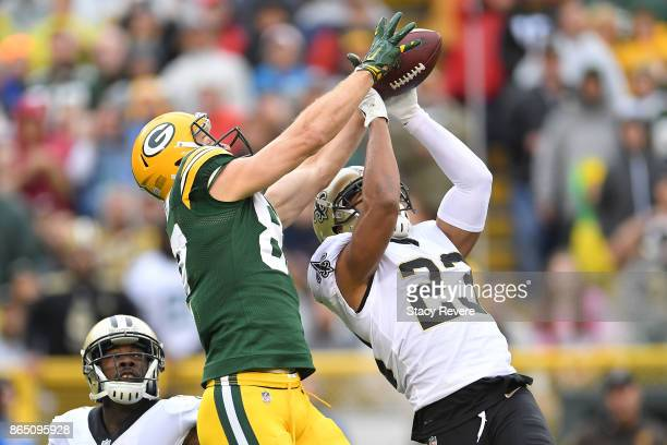 Marshon Lattimore of the New Orleans Saints defends a pass intended for Jordy Nelson of the Green Bay Packers during the second quarter at Lambeau...