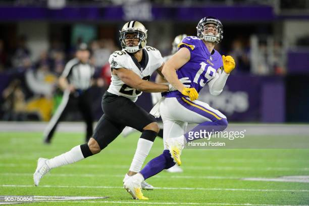 Marshon Lattimore of the New Orleans Saints defends against Adam Thielen of the Minnesota Vikings during the second half of the NFC Divisional...