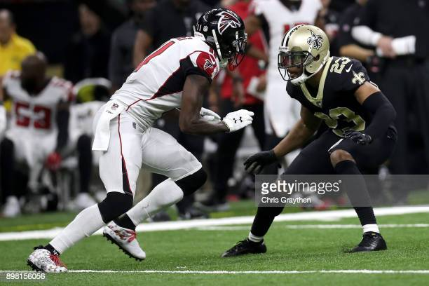 Marshon Lattimore of the New Orleans Saints defends against Julio Jones of the Atlanta Falcons at MercedesBenz Superdome on December 24 2017 in New...