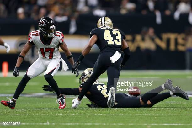 Marshon Lattimore of the New Orleans Saints intercepts a pass during the first half of a game against the Atlanta Falcons at the MercedesBenz...