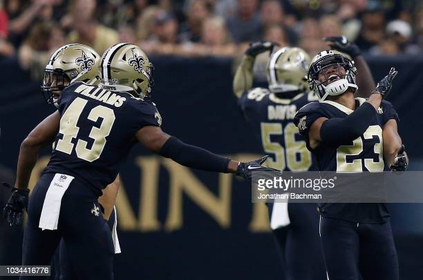 Marshon Lattimore of the New Orleans Saints reacts to a tackle with Marcus Williams of the New Orleans Saints during the second quarter against the...
