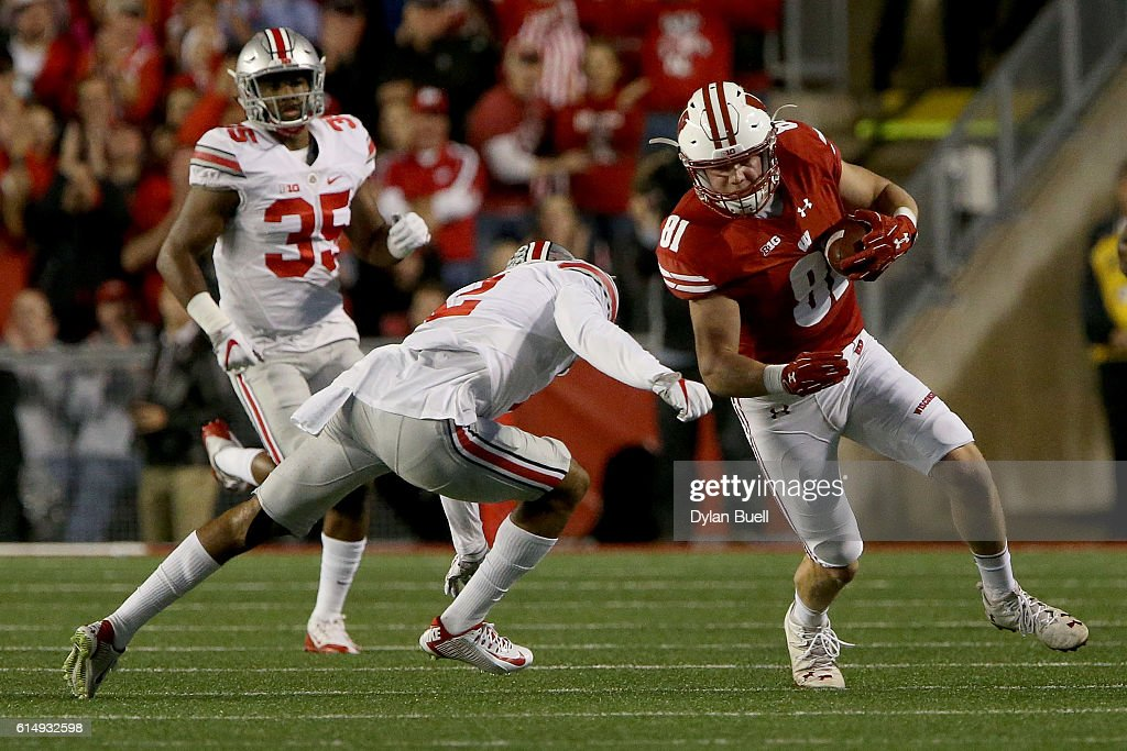 Marshon Lattimore #2 of the Ohio State Buckeyes tackles Troy Fumagalli #81 of the Wisconsin Badgers in the first quarter at Camp Randall Stadium on October 15, 2016 in Madison, Wisconsin.