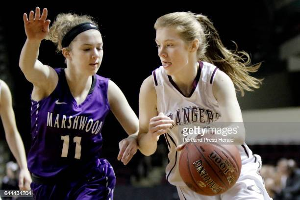 Marshwood's Courtney Thim tires to guard the lane against a driving Anna DeWolfe of Greely during the Class A South girls basketball semifinal at the...
