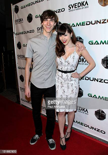 Marston Hefner and girlfriend Playboy Playmate of the year Claire Sinclair arrive at the E3 red carpet launch party at Suede in the Westin...