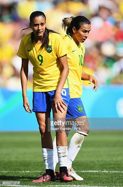 Marta and Andressa Alves of Brazil look dejected during the Olympic Womens Semi Final Football match between Brazil and Sweden at Maracana Stadium on...