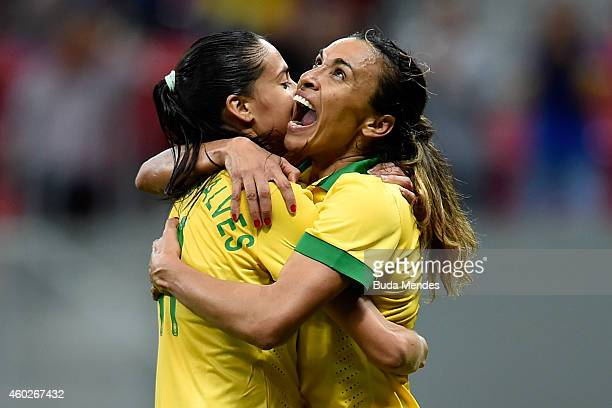 Marta and Andressa of Brazil celebrate the victory against Argentina during a match between Brazil and Argentina as part of International Women's...
