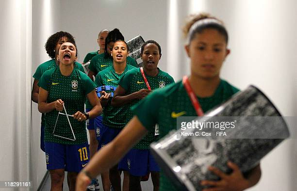 Marta and her Brazil teammates play instruments as they walk to their dressing room prior to the FIFA Women's World Cup 2011 Group D match between...