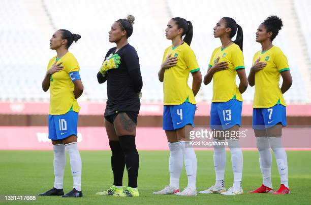 Marta, Barbara, Rafaelle, Bruna Benites and Duda of Team Brazil stand for the national anthem prior to the Women's Quarter Final match between Canada...