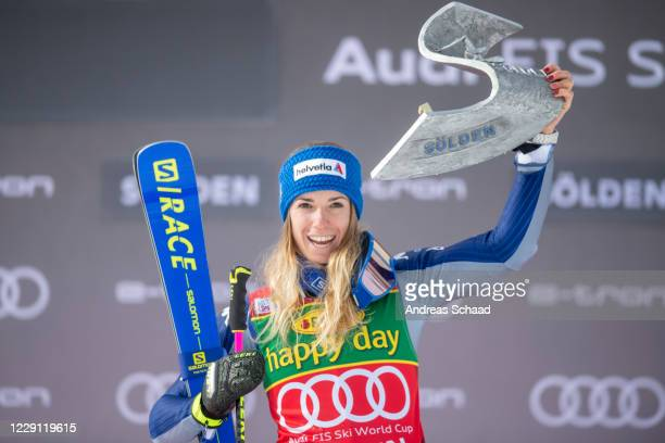 Marta Bassino of Italy celebrates with her trophy during the victory ceremony for the Women's Giant Slalom of the Audi FIS Alpine Ski World Cup on...
