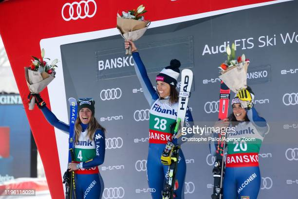 Marta Bassino of Italy takes 2nd place Elena Curtoni of Italy takes 1st place Federica Brignone of Italy takes 3rd place during the Audi FIS Alpine...