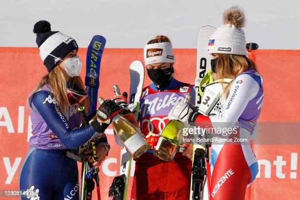 Marta Bassino of Italy takes 2nd place, Lara Gut-behrami of Switzerland takes 1st place, Corinne Suter of Switzerland takes 3rd place during the Audi...