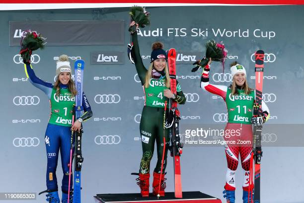 Marta Bassino of Italy takes 2nd place, Mikaela Shiffrin of USA takes 1st place, Katharina Liensberger of Austria takes 3rd place during the Audi FIS...