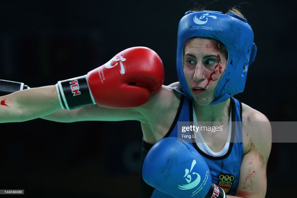 Marta Branas Rumbo (Blue) of Spain fights against Kim Ye-Ji (Red) of South Korea in the Women's 51kg preliminary match during the AIBA Women's World Boxing Championships on May 12, 2012 in Qinhuangdao, China. The AIBA Women's World Boxing Championships 2012 which is a London Olympic Games Qualifying Event will be held from May 11 to 19.