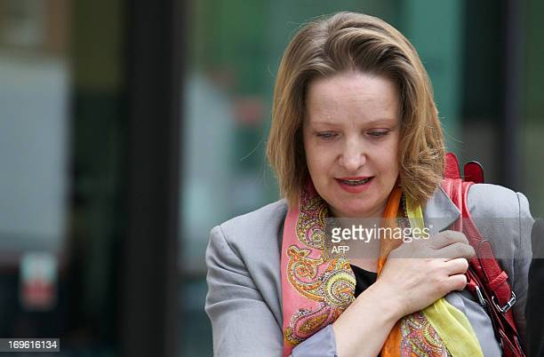 Marta Bukarewicz partner of HMRC press officer Jonathan Hall leaves Westminster Magistrates Court in central London on May 29 2013 where she and...
