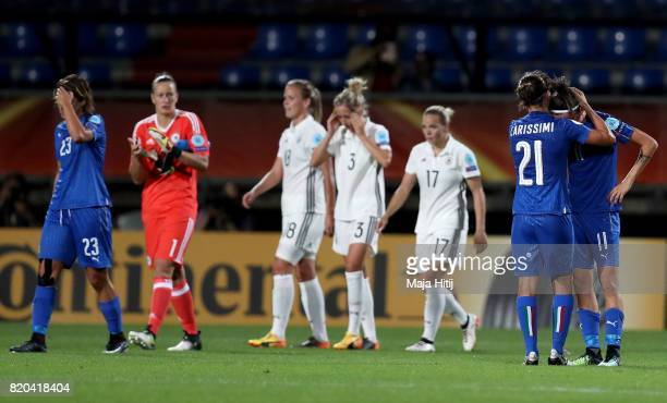 Marta Carissimi and Barbara Bonansea of Italy look dejected after the Group B match between Germany and Italy during the UEFA Women's Euro 2017 at...
