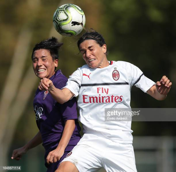 Marta Carissimi of AC Milan jumps for the ball against Alice Parisi of Fiorentina Women's FC during the Serie A match between AC Milan Women and...