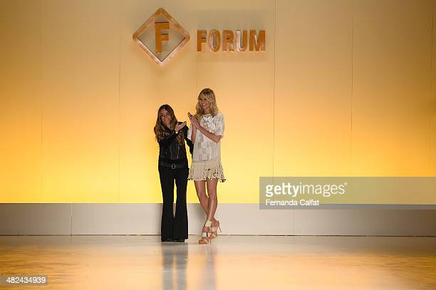 Marta Ceribelli and Candice Swanpoel model walks the runway during the Forum show at Sao Paulo Fashion Week Summer 2014/2015>> at Parque Candido...