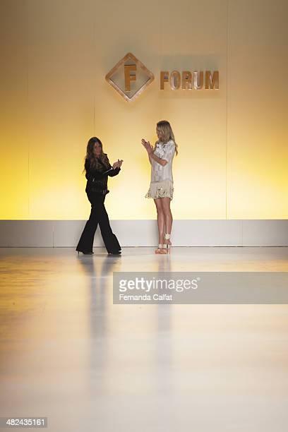 Marta Ciribelli and Candice Swanpoel walk the runway during the Forum show at Sao Paulo Fashion Week Summer 2014/2015 at Parque Candido Portinari on...