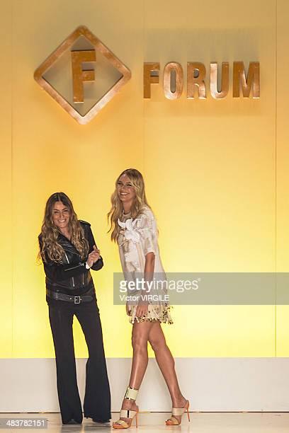 Marta Ciribelli and Candice Swanpoel walk the runway during the Forum show at Sao Paulo Fashion Week Spring Summer 2014/2015 at Parque Candido...