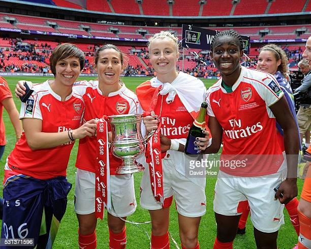 Marta Corredera Fara Williams Leah Williamson and Asisat Oshoala of Arsenal Ladies with the FA Cup Trophy after the match between Arsenal Ladies and...