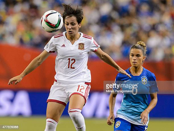 Marta Corredera of Spain jumps for the ball with Tamires of Brazil running close behind during the 2015 FIFA Women's World Cup Group E match at...