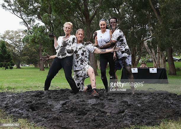 Marta Dusseldorp Greig PickhaverTerri Biviano and Michael Wipfli pose after participating in a mud fight to raise awareness about the 'Mud Pie...
