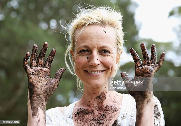 Marta Dusseldorp poses after participating in a mud fight to raise awareness about the 'Mud Pie Project' to help raise funds to complete the Ian...