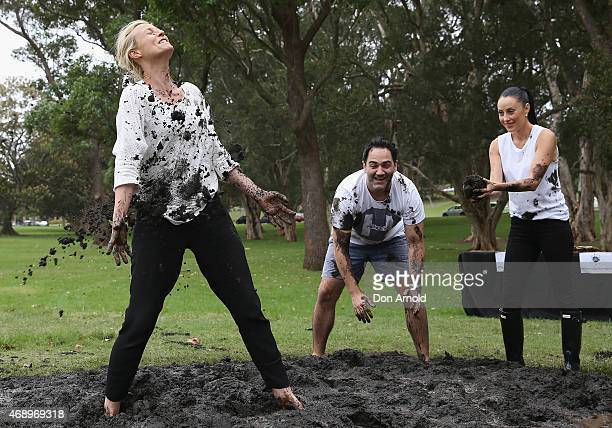 Marta DusseldorpMichael Wipfli and Terri Bivianoparticipate in a mud fight to raise awareness about the 'Mud Pie Project' to help raise funds to...