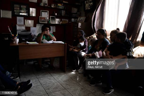 """Marta Esquivel, who works at Iglesia Metodista """"El Buen Pastor"""" Migrant Shelter receives a group of 20 migrants who recently arrived in Juarez with..."""