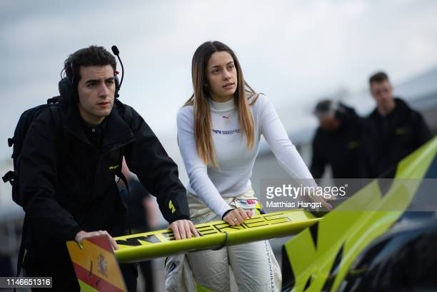 Marta Garcia of Spain pushes her car during a training session prior to the first race of the W Series at Hockenheimring on May 03 2019 in Hockenheim...