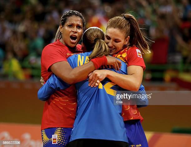 Marta Gonzalez Mangue,Silvia Gimenez Navarro and Carmen Berenguer Martin of Spain celebrate the win over Angola on Day 9 of the Rio 2016 Olympic...