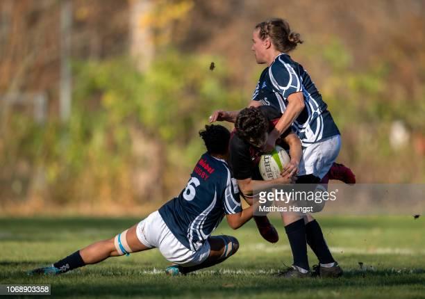 Marta Heras of Köln is tackled by Amelie Harris of Neuenheim and Marlis Gerigk of Neuenheim during the Women's Rugby Bundesliga match between SC...