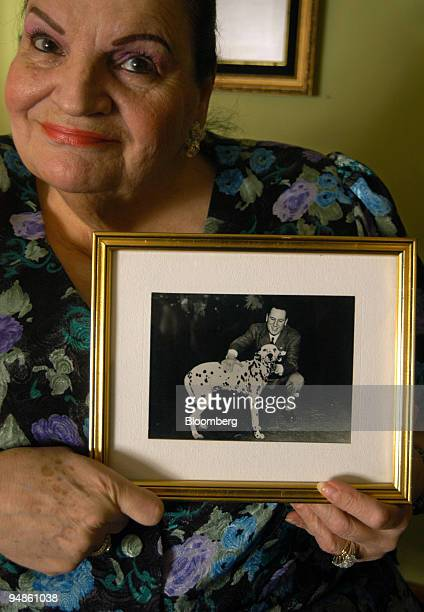 Marta Holgado shows a portrait of her alleged father General Juan Domingo Peron at her home in Buenos Aires Argentina on October 12 2005 The 71...
