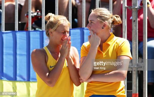 Marta Kostyuk and Dasha Lopatetskaya of Ukraine watch the singles match between Daria Gavrilova of Australia and Nadiia Kichenok of Ukraine during...